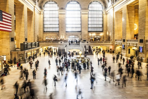 Image of people buzzing through grand central in an article about being busy