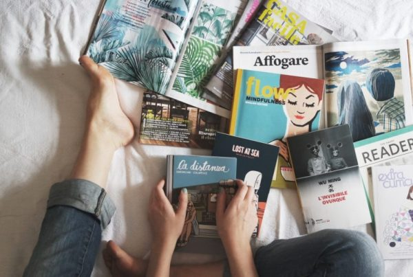 Image of books and magazines for an article about weekend reads
